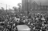 Hundreds of onlookers surrounding cars outside Ebenezer Baptist Church at Martin Luther King,...