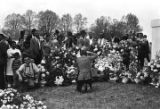 Mourners standing behind floral arrangements at Martin Luther King, Jr.'s grave site in South View...