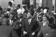 Mourners walking down Auburn Avenue to Ebenezer Baptist Church for Martin Luther King, Jr.'s...
