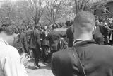 Pallbearers, including T. Y. Rogers, James Bevel, and Jesse Jackson, waiting to roll Martin Luther...