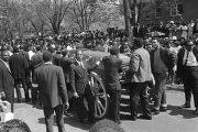 Pallbearers, including T. Y. Rogers, James Bevel, James Orange, and Jesse Jackson, waiting to roll...