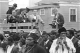 Photographers standing on a truck behind a crowd of mourners on Auburn Avenue during Martin Luther...