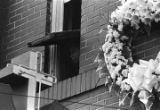 Woman looking out of an upper level window at Ebenezer Baptist Church during Martin Luther King,...