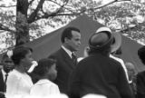 Harry Belafonte and other mourners at South View Cemetery for Martin Luther King, Jr.'s funeral.