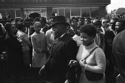 Man and woman walking down Auburn Avenue toward Ebenezer Baptist Church for Martin Luther King,...