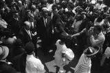 Robert F. Kennedy walking through the crowd at Martin Luther King, Jr.'s funeral.