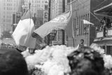 Flags being carried down the street during Martin Luther King, Jr.'s funeral procession.
