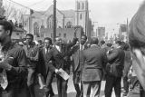 Floyd McKissick walking down Auburn Avenue toward Ebenezer Baptist Church for Martin Luther King,...