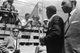 Man speaking to photographers in the back of a truck parked on Auburn Avenue during Martin Luther...