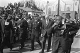 Policemen escorting presidential candidate Senator Eugene McCarthy to Ebenezer Baptist Church for...