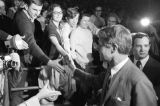 Robert F. Kennedy shaking hands with audience members as he arrives to speak at the University of...