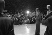 Robert F. Kennedy on a stage before a large audience at the University of Alabama during the...