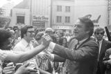 Sargent Shriver shaking hands with people while walking through a crowd in downtown Atlanta,...