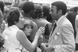 Andrew Young speaking to a woman in a crowd in downtown Atlanta, Georgia, during the Democratic...