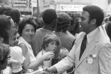 Andrew Young shaking hands with a woman in a crowd in downtown Atlanta, Georgia, during the...