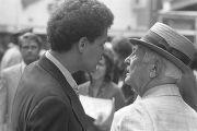 Julian Bond speaking to a man standing on a street in downtown Atlanta, Georgia, during the...