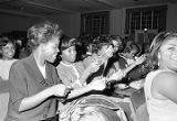 Young women snapping their fingers in the audience during a performance of the Otis Redding Show...