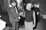 Aaron Neville and a woman backstage at the Montgomery City Auditorium during a performance of the...