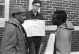 Scott B. Smith of SNCC speaking with Mike Bibler and John Davis of SCLC, in front of the Barbour...