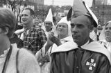 Klansmen and other audience members listening to a speaker at a Ku Klux Klan rally in Montgomery,...