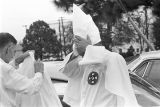 Klansmen removing their hoods and robes after a Ku Klux Klan rally in Montgomery, Alabama.