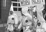 Klansmen marching in a parade during a Ku Klux Klan rally in Montgomery, Alabama.
