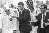 Journalist interviewing a Klansman during a parade at a Ku Klux Klan rally in Montgomery, Alabama.