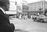 Man watching a parade during a Ku Klux Klan rally in Montgomery, Alabama.