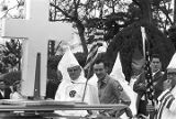 Klansmen holding American flags at a Ku Klux Klan rally in Montgomery, Alabama.