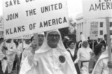 Klansmen and other marchers carrying signs in a parade during a Ku Klux Klan rally in Montgomery,...