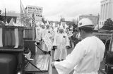 Klansmen standing behind two pickup trucks during a Ku Klux Klan rally in Montgomery, Alabama.
