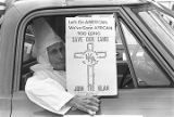 Elderly Klansman in a truck during a Ku Klux Klan rally in Montgomery, Alabama.