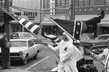 Klansmen carrying Confederate and American flags in a parade during a Ku Klux Klan rally in...