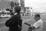 Cameraman filming a parade during a Ku Klux Klan rally in Montgomery, Alabama.