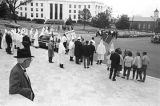 Klansmen and other observers standing in front of the Capitol during a Ku Klux Klan rally in...