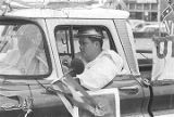 Two Klansmen in a pickup truck at a Ku Klux Klan rally in Montgomery, Alabama.