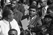 Muhammad Ali signing autographs during homecoming activities for Alabama State College on...