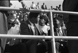 Muhammad Ali sitting in the bleachers during homecoming activities for Alabama State College on...