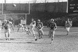 Football teams playing on the field during the Turkey Day Classic, the annual football game held...
