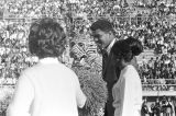 Muhammad Ali on the football field with the mascot and cheerleaders from Tuskegee Institute during...