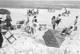 Group of children, teenagers, and adults at Johnson Beach in Pensacola, Florida, during spring...