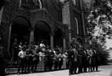 Students and faculty from Tuskegee Institute standing on the front steps of Tuskegee Methodist...