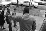 L. L. Anderson and others, standing on the steps outside Tabernacle Baptist Church in Selma,...