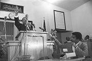 Martin Luther King, Jr., speaking to an audience at Maggie Street Baptist Church in Montgomery,...