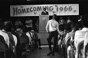 Man speaking on stage during a homecoming rally at Booker T. Washington High School in Montgomery,...