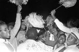 Students cheering during a rally at the homecoming bonfire at Booker T. Washington High School in...