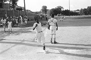 Boy running across home plate during a baseball game, probably in Montgomery, Alabama.