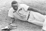 Baseball player lying on the grass during a game played by teams of an amateur baseball league in...
