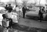 Ralph Abernathy getting out of a car, probably outside First Baptist Church in Eutaw, Alabama.