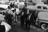 Martin Luther King, Jr., William M. Branch, Ralph Abernathy and others, greeting people after...